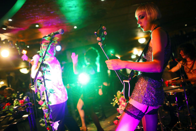 """The band """"PLeaSureDomE"""" performs at a pub at the Europa Center in Berlin, Germany, September 3, 2016. """"PLeaSureDomE"""" plays glam rock, with distinctive outfits to match. Here they play at a huge Irish pub at the Europa Center in west Berlin. (Photo by Hannibal Hanschke/Reuters)"""