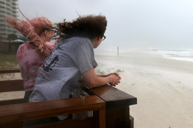 Jordan Spence and Dawson Stallworth watch waves come ashore as Hurricane Sally approaches in Orange Beach, Alabama, U.S., September 15, 2020. (Photo by Jonathan Bachman/Reuters)