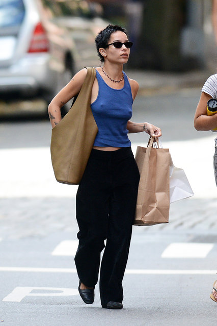 "American actress, singer and model Zoe Kravitz is spotted out and about with a friend in New York City on October 6, 2020. The 31 year old ""Batman"" star carried a large tote bag and wore a blue tank top, black trousers, and matching flats. (Photo by TheImageDirect.com)"