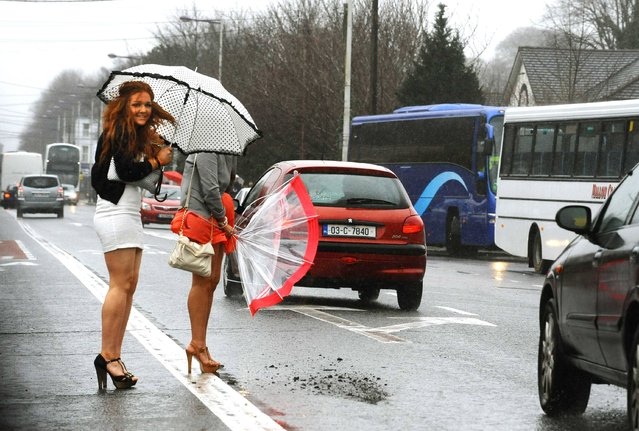 Students battling the bad weather conditions in Cork City, UK, as they head for the Mallow Easter Festival, on March 21, 2013. (Photo by Denis Scannell)