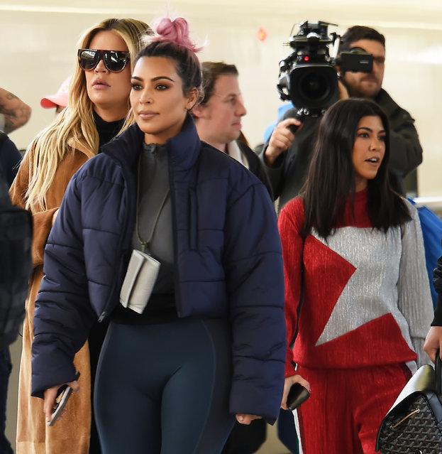 Kim Kardashian, Kourtney Kardashian and Khloe Kardashian are seen upon arrival at Tokyo Station on March 2, 2018 in Tokyo, Japan. (Photo by Jun Sato/GC Images)