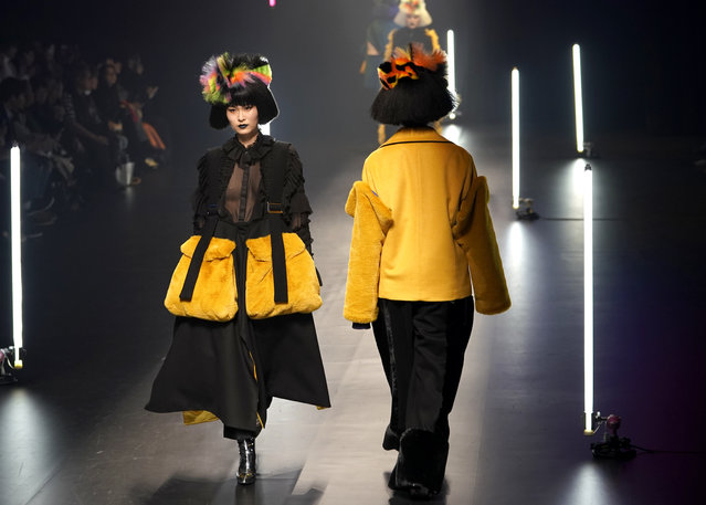 Model display creations by Chinese born Viviano Sue during the 2018 Autumn/Winter Collection at the Tokyo Fashion Week in Tokyo, Wednesday, March 21, 2018. (Photo by Shizuo Kambayashi/AP Photo)