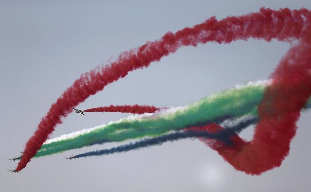 Al Fursan, the UAE Air Force aerobatic display team, perform during the opening of the Dubai Airshow in United Arab Emirates, Sunday, November 8, 2015. (Photo by Kamran Jebreili/AP Photo)
