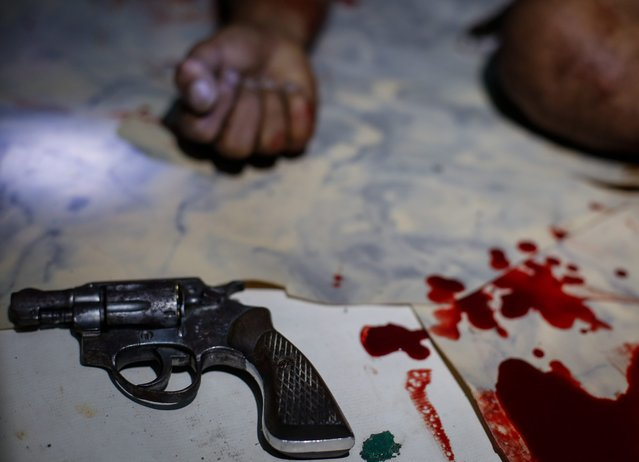 """A pistol is seen next to fresh blood stains near the body of an alleged drug dealer, who was killed in a police operation against illegal drugs, in Manila, Philippines, 12 July 2016. Recent figures released by the Philippine National Police (PNP) show that from July to September 2016 around 3,500 people have been killed during the anti-drug campaign, with over a 1,000 killed in police operations and the rest by so-called """"vigilantes"""" or in unexplained killings that are under investigation by the police. With a death rate of about 38 people per day, over 700,000 people involved in the drug trade 'voluntarily surrendered' to authorities for fear of being killed and over 16,000 have been arrested. Most of the targeted individuals are suspected by police or vigilantes of their involvement in illegal drug trade, including drug users and drug distributors. (Photo by Mark R. Cristino/EPA)"""