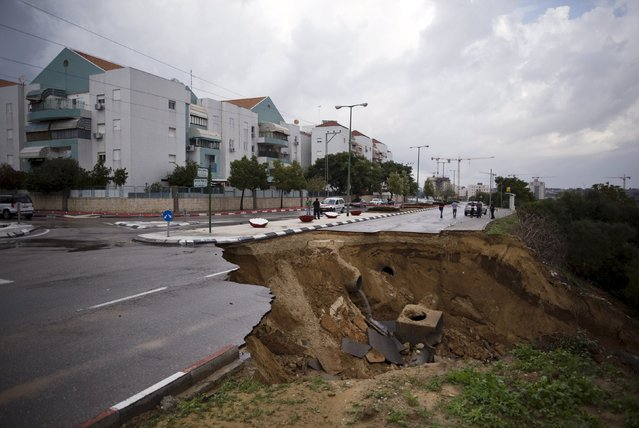 A partially collapsed street is seen in the southern city of Ashkelon, Israel, November 9, 2015. (Photo by Amir Cohen/Reuters)