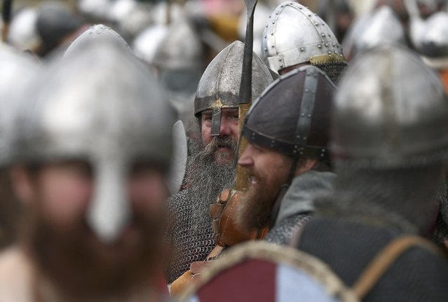 Re-enactors participate in a demonstration before a re-enactment of the the Battle of Hastings on the 950th anniversary of the battle, in Battle, Britain October 15, 2016. (Photo by Neil Hall/Reuters)