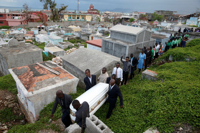 People carry the coffin of a woman who died during Hurricane Matthew in Jeremie, Haiti, October 18, 2016. (Photo by Carlos Garcia Rawlins/Reuters)