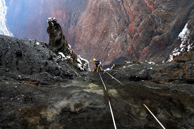 Intrepid explorers descendi nto the Marum Volcano in Vanuatu. (Photo by Bradley Ambrose/Caters News)