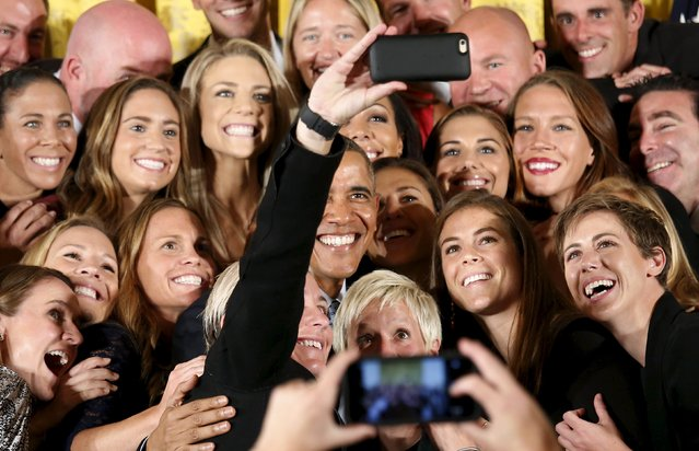 U.S. President Barack Obama poses for a selfie taken by veteran star player Abby Wambach as he welcomes the United States Women's National Soccer Team to the White House in Washington to honor their victory in the 2015 FIFA Women's World Cup, October 27, 2015. (Photo by Kevin Lamarque/Reuters)