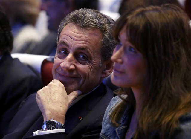 Nicolas Sarkozy (L), former head of the Les Republicains political party, looks over at his wife Carla Bruni-Sarkozy as they attend a political rally as he campaigns for the French centre-right presidential primary in Toulon, France, October 21, 2016. (Photo by Jean-Paul Pelissier/Reuters)