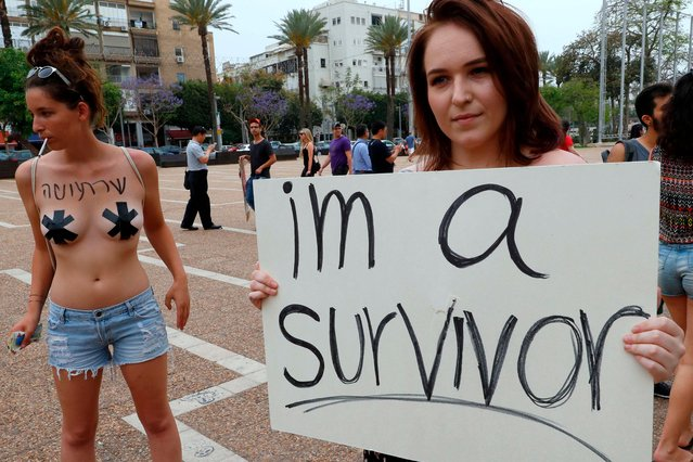 "Participants of the annual ""SlutWalk"" march through the Israeli Mediterranean coastal city of Tel Aviv on May 4, 2018 to protest against rape culture, including sexual assault and harassment directed at women. The campaign, which has gained international notoriety, was inspired by group of Canadian women who launched the protest in 2011 in response to a policeman' s comment that if women want to avoid being attacked they should not dress like sl*ts. (Photo by Jack Guez/AFP Photo)"