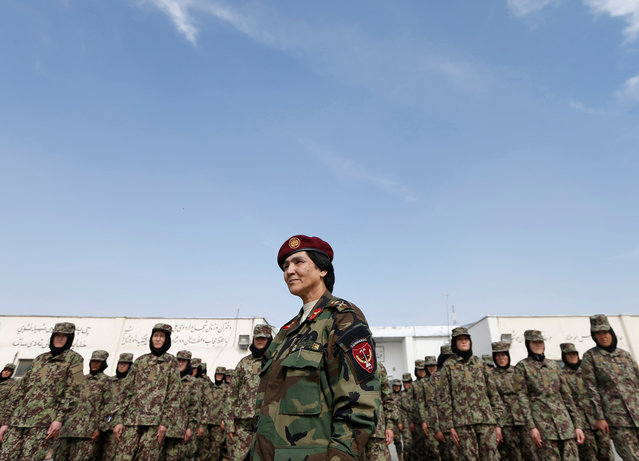 Commander of female soldiers, Lieutenant Colonel Cobra Tanha, 45, stands in front of her soldiers at the Kabul Military Training Centre (KMTC) in Kabul, Afghanistan, October 23, 2016. (Photo by Mohammad Ismail/Reuters)