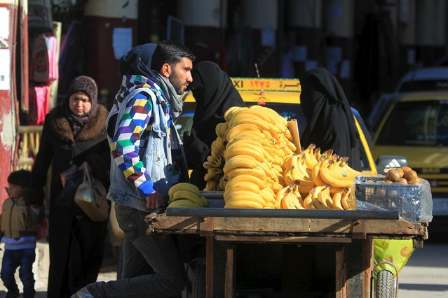 A man displays bananas for sale in Idlib, Syria December 6, 2015. (Photo by Ammar Abdullah/Reuters)