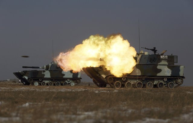 A tank of the People's Liberation Army (PLA) Marine Corps fires during a military drill at a military base in Taonan, Jilin province January 25, 2015. (Photo by Reuters/China Daily)