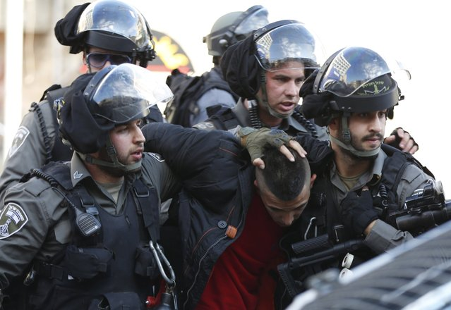 Israeli border policemen detain a Palestinian protester during clashes near Jerusalem's Old City December 26, 2015. (Photo by Ammar Awad/Reuters)