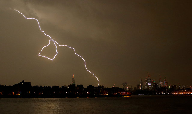 General view as lightning strikes over the city of London, Britain May 26, 2018. (Photo by Tom Jacobs/Reuters)