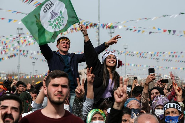 Supporters of pro-Kurdish Peoples' Democratic Party (HDP) gather to celebrate Newroz, which marks the arrival of spring, in Diyarbakir, Turkey March 21, 2021. (Photo by Sertac Kayar/Reuters)