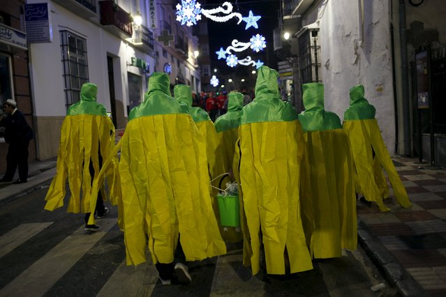 Revellers dressed up as mops take part in New Year celebrations in Coin, near Malaga, southern Spain, January 1, 2016. (Photo by Jon Nazca/Reuters)