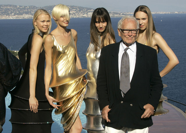In this October 6, 2008 file photo, French fashion designer Pierre Cardin stands with models wearing his creations at his villa in Theoule sur Mer, southern France. France's Academy of Fine Arts says Pierre Cardin, the French designer whose Space Age style was among the iconic looks of 20th-century fashion, has died at 98. (Photo by Lionel Cironneau/AP Photo/File)