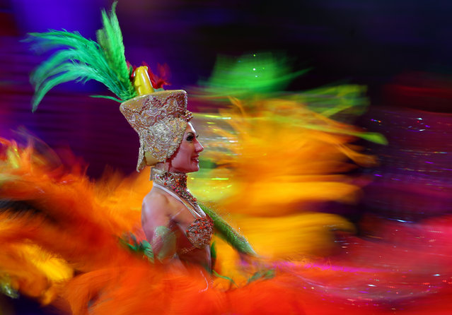 A costumed performer is seen during the Feyeriya (Extravaganza) Show at the Ivanovo State Circus in Ivanovo, Russia on April 3, 2021. On 3 April 2021, the circus resumed performances after being shutdown for a year in connection with the COVID-19 pandemic. (Photo by Vladimir Smirnov/TASS)