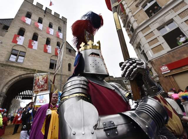 A knight parades in the street during the traditional carnival parade in Cologne, western Germany, Monday, February 16, 2015. (Photo by Martin Meissner/AP Photo)