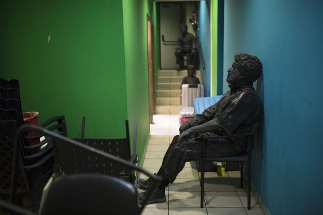 "An actor from the Israeli theatre group Orto-Da rests in a dressing room before their show titled ""Stones"", at a theatre in Tel Aviv March 10, 2015. (Photo by Amir Cohen/Reuters)"