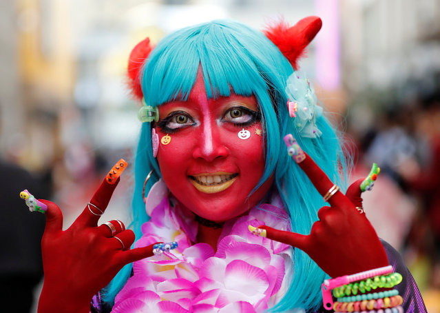A participant in costume poses for a photo during a Halloween event in Kawasaki, south of Tokyo, Japan on October 28, 2018. (Photo by Toru Hanai/Reuters)