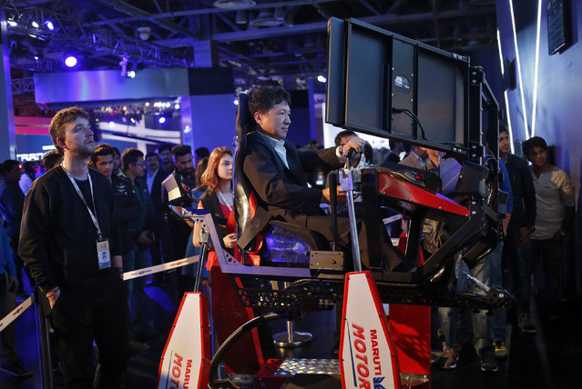 A visitor tries out Maruti Suzuki's Drive Simulator at the Indian Auto Expo in Greater Noida, on the outskirts of New Delhi, India, February 4, 2016. (Photo by Anindito Mukherjee/Reuters)