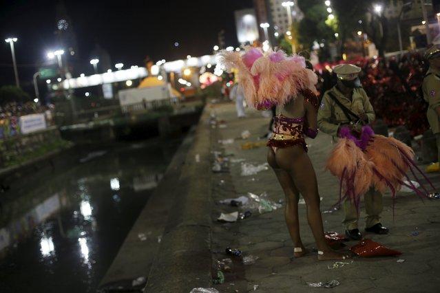 A reveller gets dressed for the carnival parade at the Sambadrome in Rio de Janeiro, February 8, 2016. (Photo by Ricardo Moraes/Reuters)