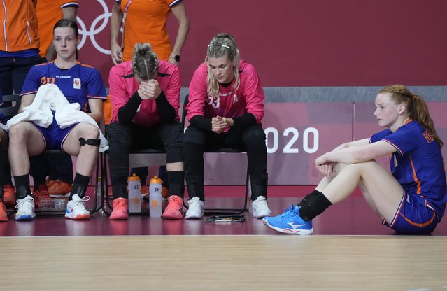 The Netherlands team players react after losing 32-22 against France during the women's quarterfinal handball match at the 2020 Summer Olympics, Wednesday, August 4, 2021, in Tokyo, Japan. (Photo by Sergei Grits/AP Photo)