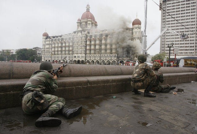 Indian army soldiers take position during a gun battle at the Taj Mahal hotel in Mumbai, November 2008. (Photo by Desmond Boylan/Reuters)