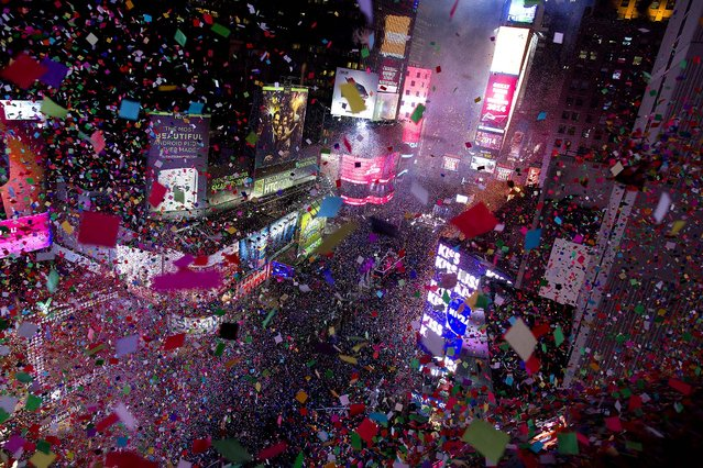 Confetti flies over Times Square in New York. (Photo by Craig Ruttle/Associated Press)