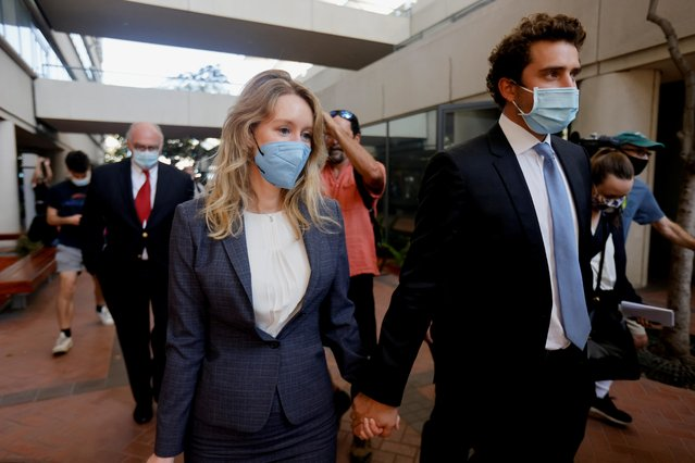 Theranos founder Elizabeth Holmes and her partner Billy Evans leaves the Robert F. Peckham U.S. Courthouse after the delivery of opening arguments in her trial, in San Jose, California, U.S., September 8, 2021. (Photo by Peter DaSilva/Reuters)