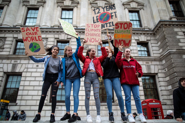 Schoolchildren take part in a student climate protest on March 15, 2019 in London, England. Thousands of pupils from schools, colleges and universities across the UK will walk out today in the second major strike against climate change this year. Young people nationwide are calling on the Government to declare a climate emergency and take action. Similar strikes are taking place around the world today including in Japan and Australia, inspired by 16-year-old Greta Thunberg who criticised world leaders at a United Nations climate conference. (Photo by Jack Taylor/Getty Images)