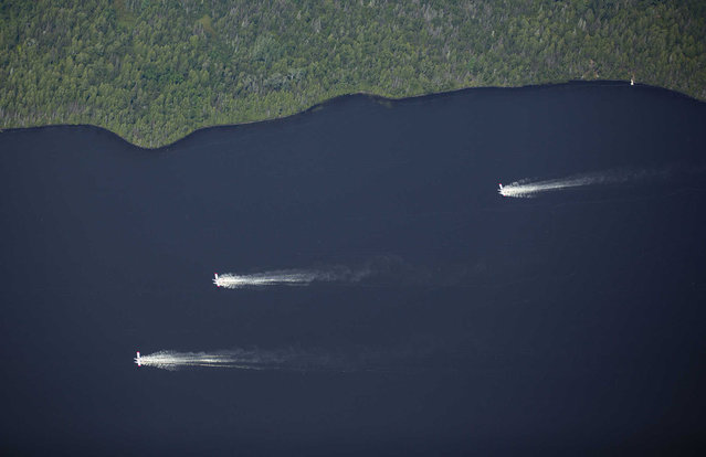 Aircrafts scoop up water from Sand Lake to drop onto the nearby Greenwood Fire, about 50 miles north of Duluth, Minn., Tuesday, August 17, 2021, as seen from an airplane above the temporary flight restriction zone. (Photo by Alex Korman/Star Tribune via AP Photo)
