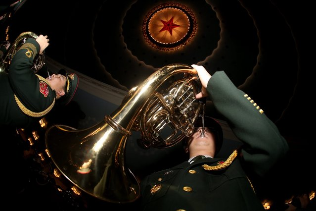 """Members of the military band practice during rehearsal ahead the closing of the Fourth Session of the 12th National Committee of the Chinese People's Political Consultative Conference (CPPCC) at the Great Hall of the People (GHOP) in Beijing, China, 14 March 2016. The CPPCC is the top advisory body of the Chinese political system and runs alongside the annual plenary meetings of the 12th National People's Congress (NPC), together known as """"Lianghui"""" or """"Two Meetings"""". (Photo by Wu Hong/EPA)"""
