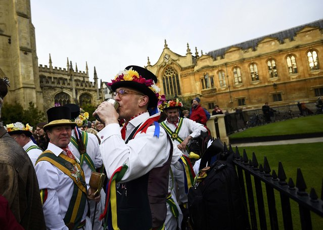 Morris Dancers drink from pewter tankards as they celebrate beside Radcliffe Camera in the early hours during traditional May Day celebrations in Oxford, Britain, May 1, 2015. (Photo by Dylan Martinez/Reuters)