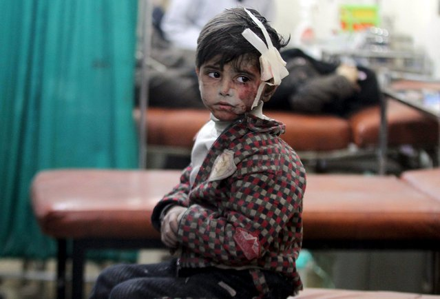 An injured boy waits inside a field hospital after what activists said were airstrikes and shelling by forces loyal to Syria's President Bashar al-Assad in the Douma neighborhood of Damascus April 22, 2015. (Photo by Mohammed Badra/Reuters)