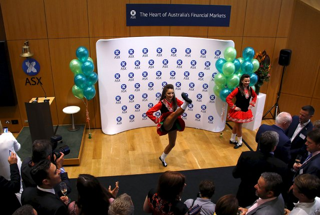 Traditional Irish dancers perform during the official listing ceremony for Irish health software maker Oneview at the Australian Securities Exchange in Sydney, Australia, March 17, 2016. The Dublin-based Oneview Healthcare produces software for hospitals, including products that can help integrate IT systems across devices like bedside terminals, televisions, tablets and smartphones. The business already sells into markets including Australia and Dubai, and has its sights on the vast US healthcare sector. (Photo by David Gray/Reuters)
