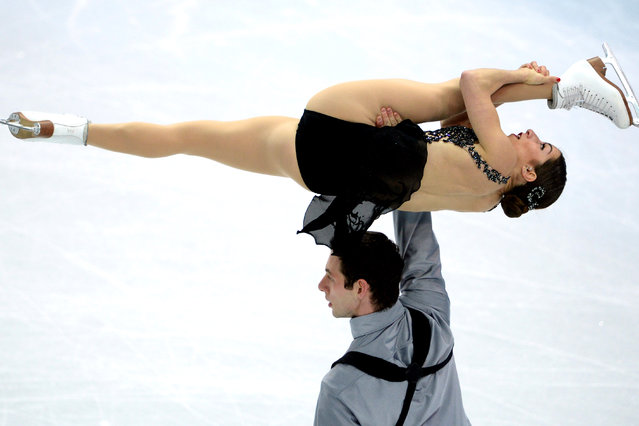 US Simon Shnapir and US Marissa Castelli perform their Figure Skating Pairs Free Program at the Iceberg Skating Palace during the Sochi Winter Olympics on February 12, 2014. (Photo by Yuri Kadobnov/AFP Photo)