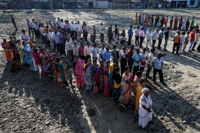 Voters line up to cast their votes outside a polling station during the first phase of general election in Alipurduar district in the eastern state of West Bengal, India, April 11, 2019. (Photo by Rupak De Chowdhuri/Reuters)