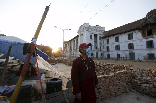 A monk looks at buildings damaged by the earthquake in Kathmandu, Nepal, May 5, 2015. (Photo by Olivia Harris/Reuters)