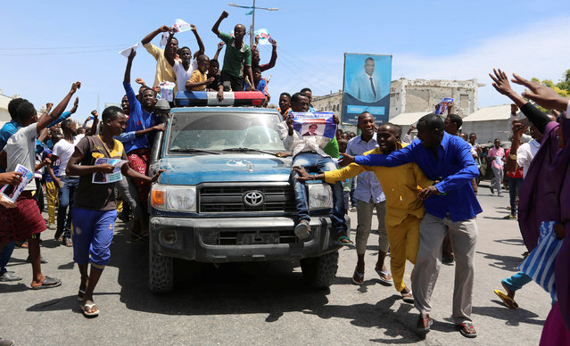Civilians ride on a Somali police car as they celebrate the election of President Mohamed Abdullahi Mohamed in the streets of Somalia's capital Mogadishu, February 9, 2017. (Photo by Feisal Omar/Reuters)