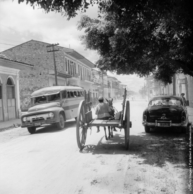 All manner of transportation can be seen on the roads of Iquitos, Peru, 1955