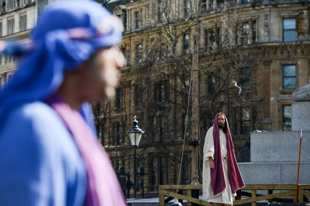 "Actor James Burke-Dunsmore speaks to his disciples whilst playing Jesus during The Wintershall's ""The Passion of Jesus"" in front of crowds on Good Friday at Trafalgar Square on March 25, 2016 in London, England. (Photo by Chris Ratcliffe/Getty Images)"