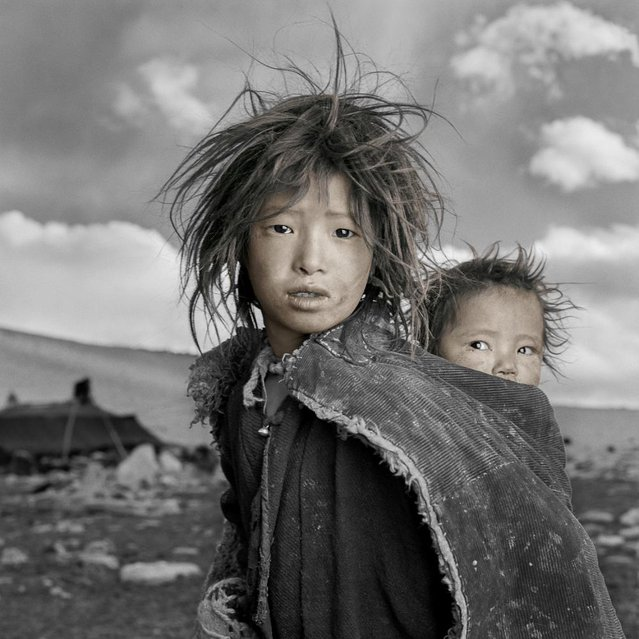 """Jigme and Sonam are sisters whose nomadic family had just come down from the Himalayan highlands to their 16,500 ft. winter camp on the Tibetan Plateau. When I gave Jigme a Polaroid of herself she looked at it, squealed and ran into her tent. I assumed that this was one of the only times she had seen herself since her family did not own a mirror"". (Phil Borges)"