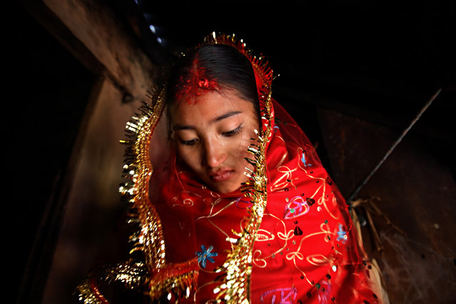 Sumeena, 15, leaves her home to meet her groom, Prakash, 16, in Kagati Village, Kathmandu Valley, Nepal on Jan. 24, 2007. (Photo by Reuters/Stringer)