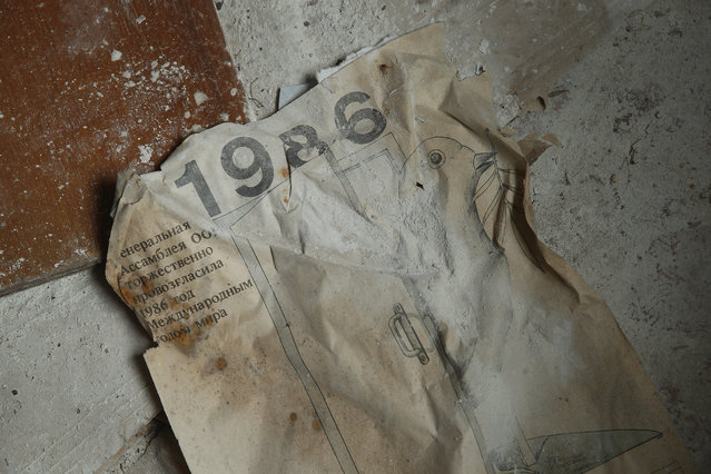 A calendar from the fateful year 1986 lies on the floor of a former hospital on April 9, 2016 in Pripyat, Ukraine. (Photo by Sean Gallup/Getty Images)