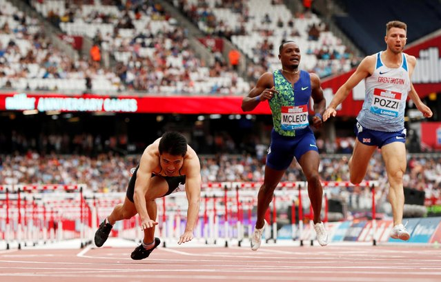 China's Xie Wenjun falls over after winning the men's 110m hurdle race at the Diamond League games in London on July 21, 2019. (Photo by John Sibley/Action Images via Reuters)