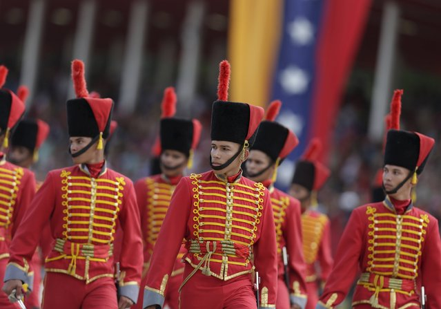 Soldiers march during a military parade to celebrate the anniversary of Venezuela's independence in Caracas, July 5, 2015. (Photo by Jorge Dan Lopez/Reuters)